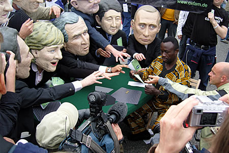 The world media focus in on G8 leaders / Oxfam Big Heads gambling with Africa's future. Credit: Craig Owen / Oxfam International.