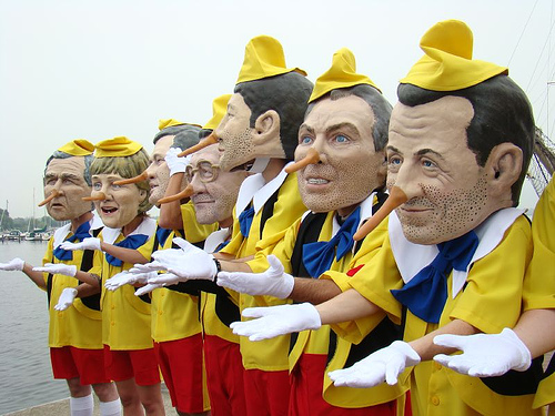Big Head puppets horsing around at Rostock Harbour